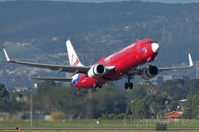 Boeing 737-800 (VH-VUL) - Adelaide, South Australia, August 10, 2014.  Afternoon departure off Rw 23.