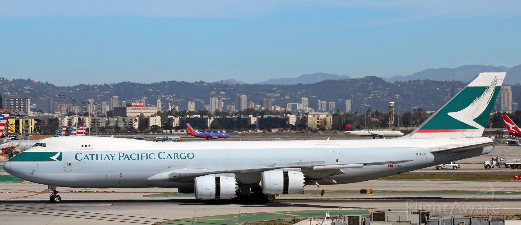 BOEING 747-8 (B-LJB) - A Cathay Pacific Cargo B748 (B-LJB) is just beginning to turn toward me after landing on LAXs runway 25L to complete the last segment of a Hong Kong-Anchorage-Los Angeles (VHHH-PANC-KLAX) run.