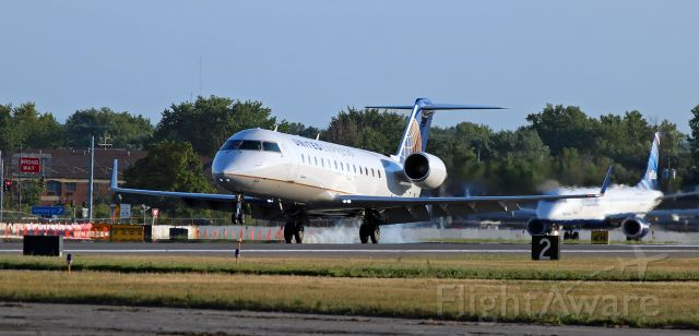 Canadair Regional Jet CRJ-200 (N464AW) - Putting the mains down on Runway 5 at the end of an early evening flight.