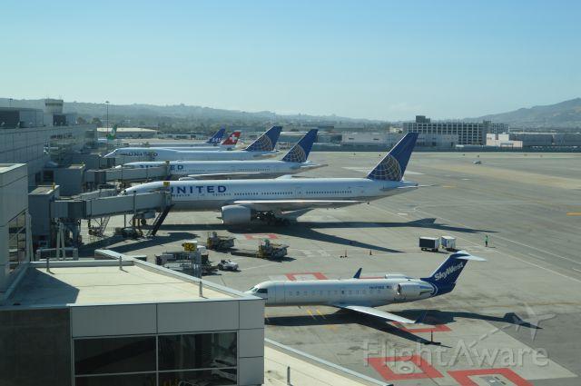 Canadair Regional Jet CRJ-200 (N699BR) - Noon time traffic at SFO, terminal I-G. Taken from United International Lounge.