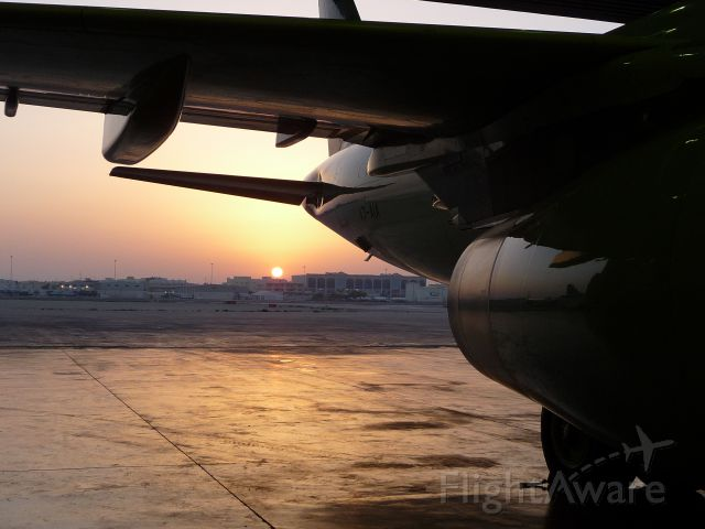 — — - View from inside the Hangar outward towards Doha and the sun