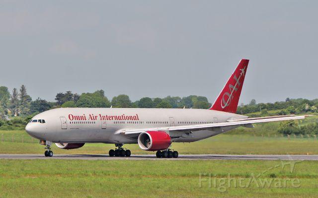 Boeing 777-200 (N819AX) - omni b777-2u8er n819ax dep shannon 23/5/18.