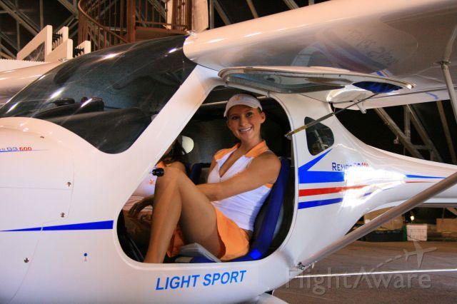 — — - Playboy golf tournament girls in a Remos light sport a/c