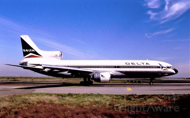 Lockheed L-1011 TriStar (N712DA) - KSFO - Delta L-1011 holding for 1R for Atlanta. There was a dirt parking lot here and one could park here for hours and get later PM photos. This color slide was taken date apprx mid June mid 1980s to 90. there is no slide date stamp on many of my slides. Minolta XD11