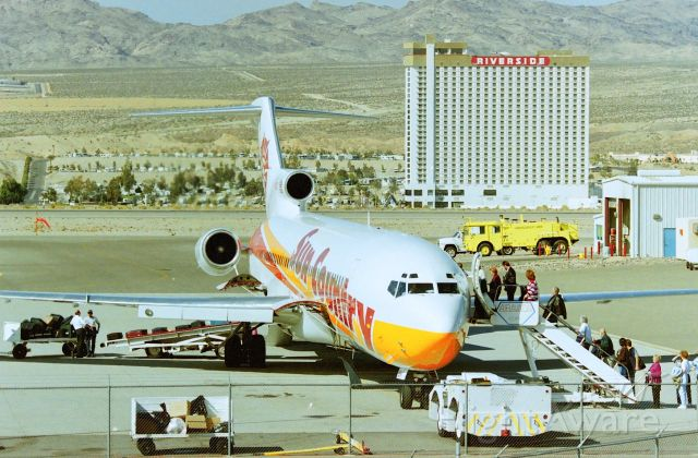 BOEING 727-200 (N284SC) - KIFP - Feb 1998 Sun Country 727-2 loading pax after a weekend junket to Laughlin,NV Casino
