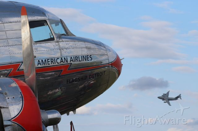 Douglas DC-3 (NC17334) - Flagship Detroit.   1937 DC-3 with a C-17 from Altus AFB OK in the pattern at Oshkosh.
