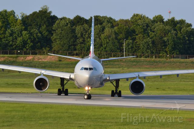 Airbus A330-300 (N270AY) - Taxiing into position runway 18C - 8/25/16