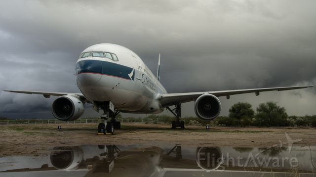 Boeing 777-200 (B-HNL) - At a museum, this 777 stands proud after weathering a nasty thunderstorm.