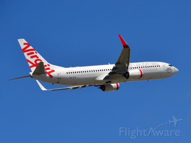 Boeing 737-800 (VH-YIE) - Getting airborne off runway 23 and heading home to tropical Bali. Saturday, 24th March 2012.