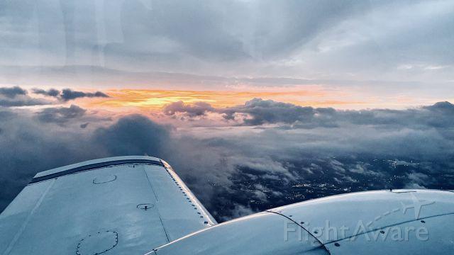 Piper Aztec (N6854Y) - Stormy sunrise flight.