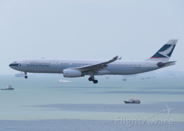 Airbus A330-300 (B-HLB) - On arrival from Doha