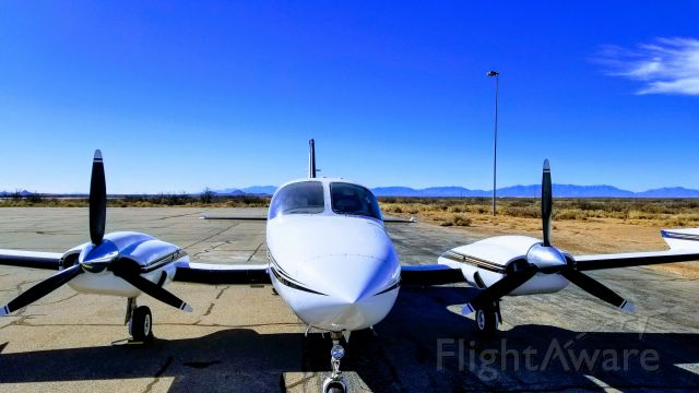 Cessna 421 (N1944G) - Beautiful day in the New Mexico Desert on Exile FBO's ramp.