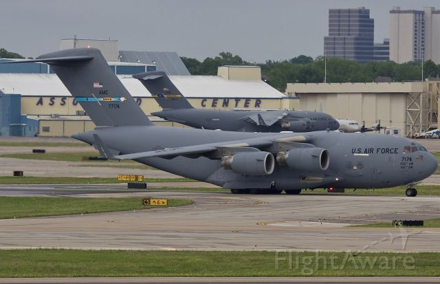 """Boeing Globemaster III (07-7174) - Military traffic at Love Field is typically light. There have been P-3s based at Love since the mid 80s for radar testing and slowly P-8s have been replacing them. On this rare occasion both POTUS and VPOTUS visited Dallas leading to a pair of C-17s being on the ground. Was excited to catch both -17s and a P-3 all in one frame back in May 2018! Later in the afternoon a US Navy T-6 Texan II arrived making it the 4th military aircraft to be at DAL in 24 hours, talk about rare! (please view in """"full"""" for highest image quality)"""