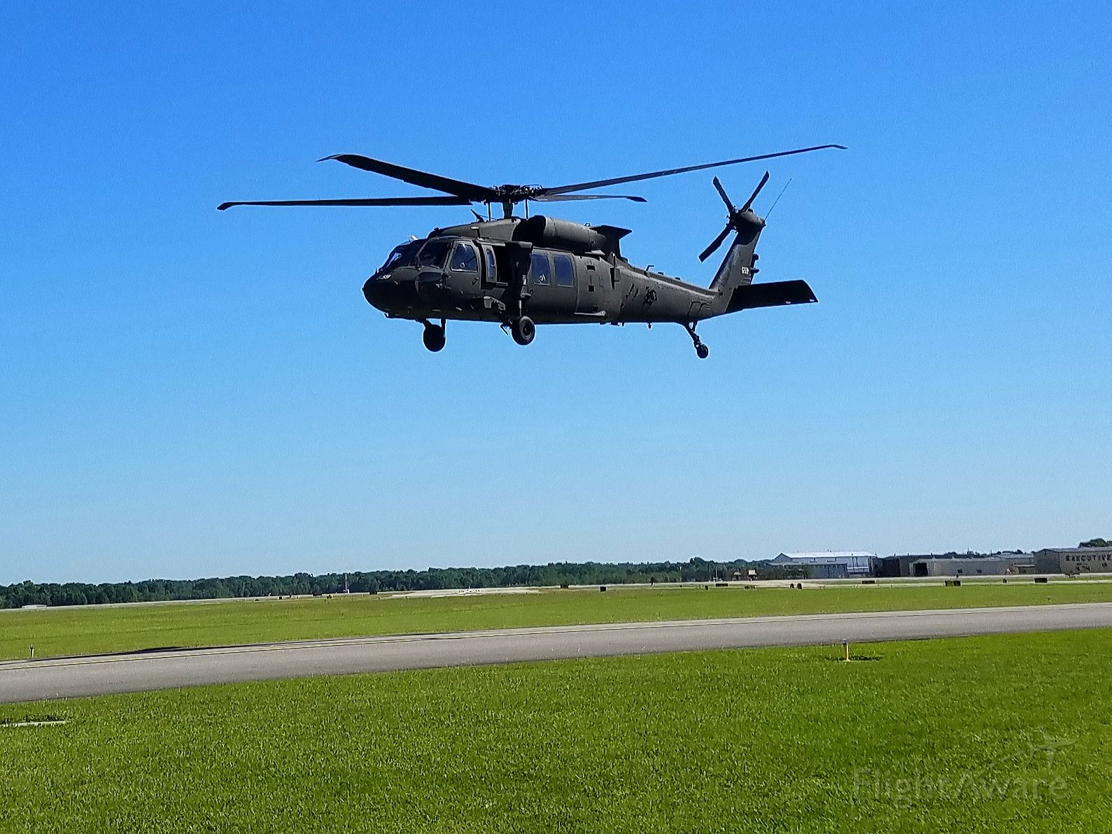 — — - I had just tied down a C172 at Baton Rouge and this helicopter was taking off on the taxiway.