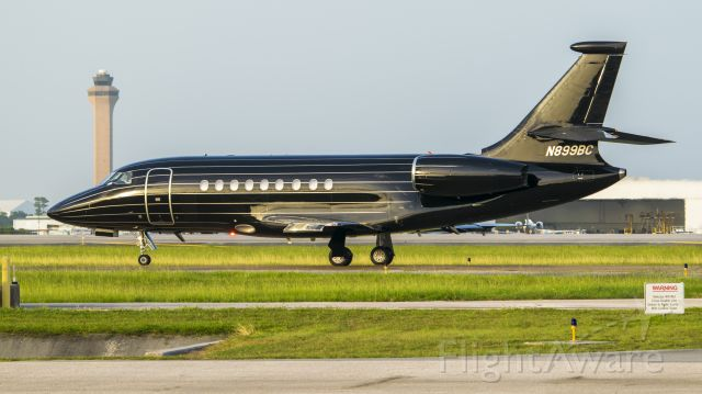 Dassault Falcon 2000 (N899BC) - N899BC beginning taxi to runway 15R from the FBO