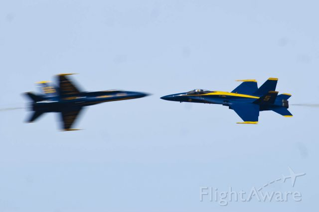 McDonnell Douglas FA-18 Hornet — - One shot, one chance, nailed it. The U.S. Blue Angels solos do an opposing pass at Tyndall AFB.