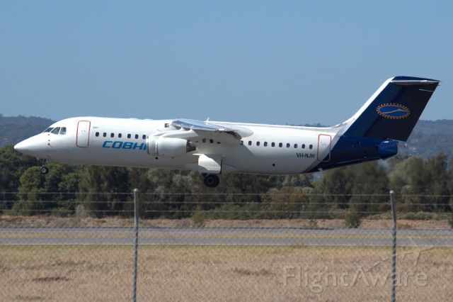 British Aerospace BAe-146-300 (VH-NJH) - Seconds from putting down on runway 05. Thursday, 4th April 2013.