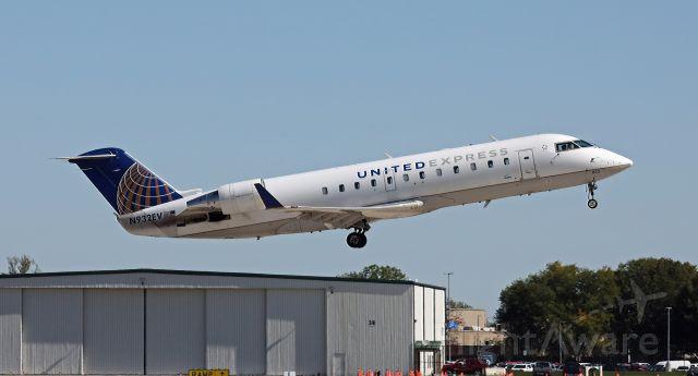 Canadair Regional Jet CRJ-200 (N932EV) - Taking off runway 14
