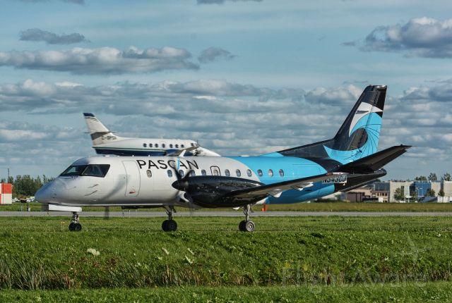 Saab 340 (N343CJ) - Taxying to 24R in CYHU for a flight to Bangor, ME.