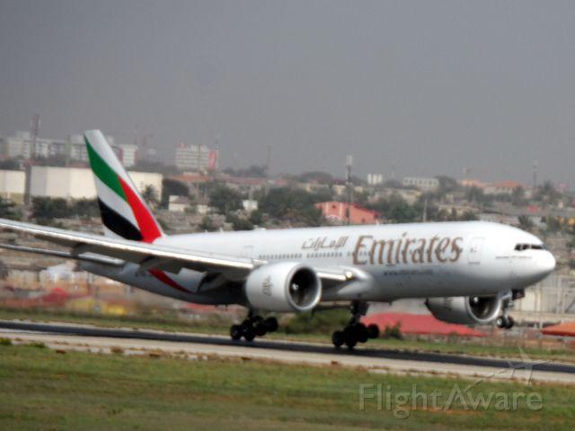 BOEING 777-300ER (A6-EWE) - UAE793 LANDING R23 FROM DUBAI TO LUANDA