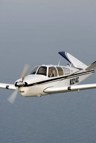 Beechcraft 35 Bonanza (N3214C) - N3214C formation shot after winning Grand Championship at Sun-N-Fun 2007