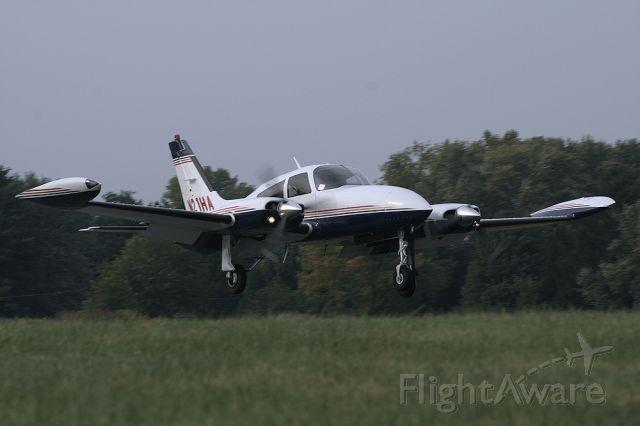 Cessna 310 (N21HA) - N21HA Landing on runway 14.