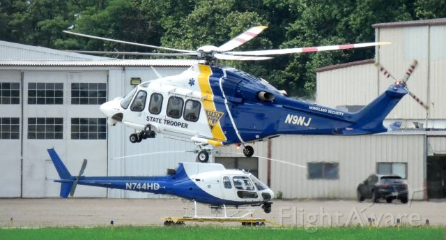 BELL-AGUSTA AB-139 (N9NJ) - Landing at the city ramp is this New Jersey State Trooper 2011 AgustaWestland AW139 helo in the Summer of 2020 while N944HD, a 1981 Eurocopter catches some tarmac time.