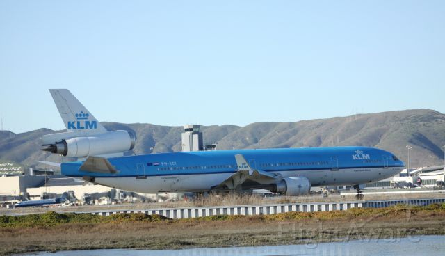Boeing MD-11 (PH-KCI) - An Old Bird, Taxiing to 28L for take off. Take off noise was huge compared to the A340