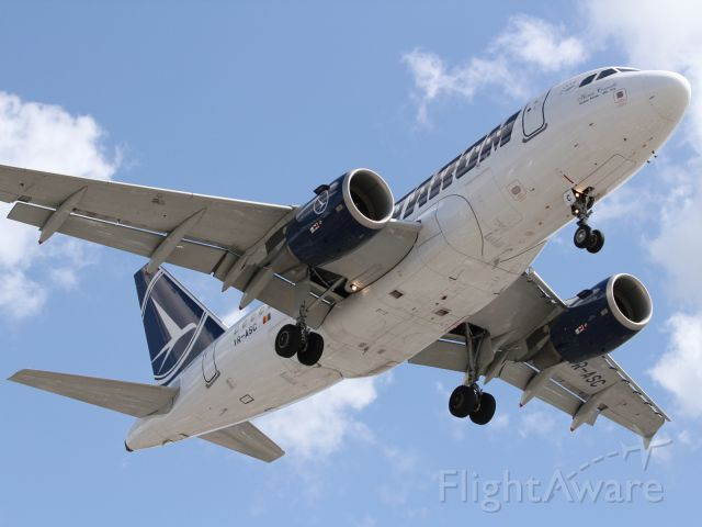 Airbus A318 (YR-ASC) - Belly shot of Tarom A318, approaching LHR runway 027R.