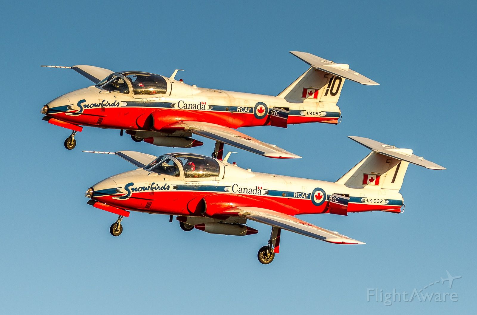 Canadair CL-41 Tutor (11-4032) - On the occasion of the Toronto Raptors winning the NBA title and subsequent parade, the Snowbirds did a flyby. Here they arrive at YYZ the night before in some glorious light, coming in as they do in tight formation.