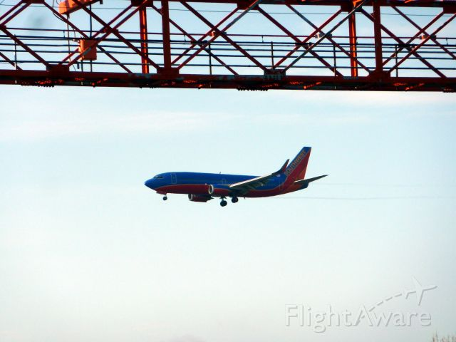 BOEING 737-300 (N628SW) - Under approach light towers