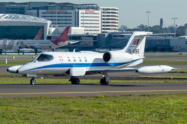 """Learjet 35 (B-4185) - Chinese Government Learjet 36 taxies past """"Shep's Mound"""" at Sydney airport"""