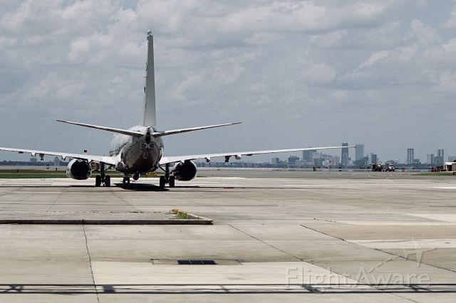 Boeing 737-700 (006) - A P-8 with the Jacksonville skyline in the background.