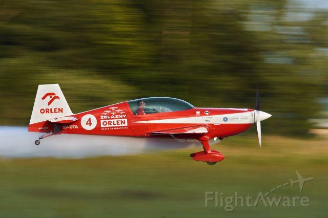 SP-UTA — - Zelazny Aerobatic Team Extra 330 on low pass at EPPT
