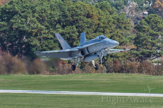 McDonnell Douglas FA-18 Hornet — - Great shot of an FA-18 landing in Atlanta's PDK airport with heavy exhaust gasses being emitted. The pilot was on a training flight and was stopping to see a friend.