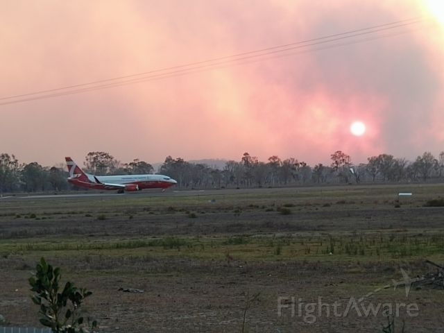 BOEING 737-300 (CGN) - The 737 Fire Bomber taking off on runway 33 to drop water at the height of the blaze that caused the evacuation of 8,000 people from Gracemere on November 30, 2018. This fire bomber and other fire fighting aircraft were instrumental in saving Gracemere and surrounding areas from destruction.