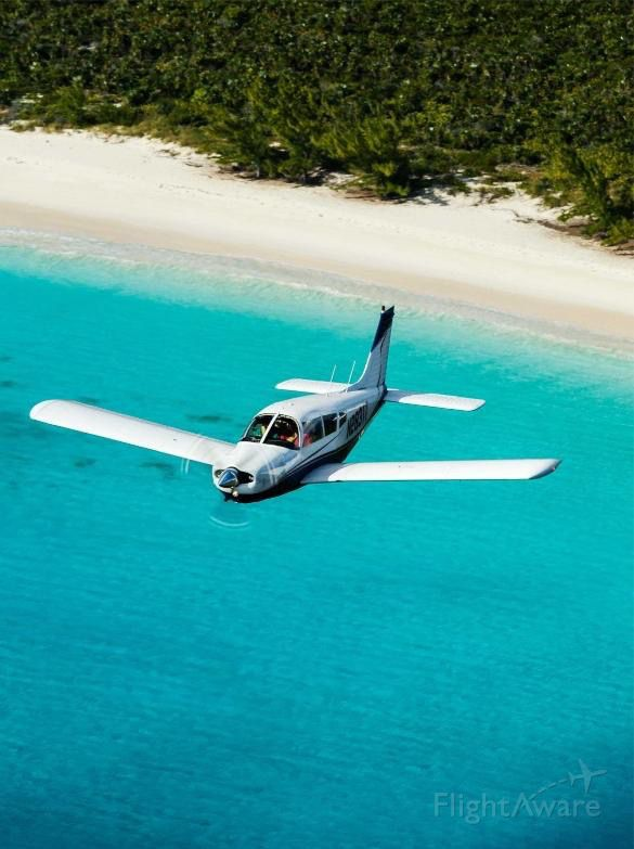 Piper Cherokee Arrow (N2831T) - I was flying in formation with a Bonanza over Cat Island Bahamas near New Bight airport.  We were staying at Fernandez Bay Village.  AOPA photographer Mike Fizer took the pic.