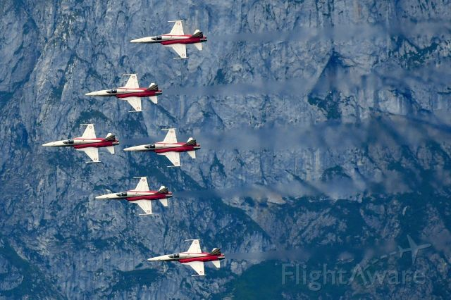 """Northrop RF-5 Tigereye (J3091) - The """"Patrouille Suisse"""", aerobatic team of the Swiss Air Force, in front of the mount Stockhorn.   08-17-2019"""