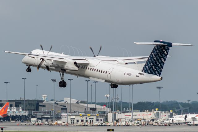 de Havilland Dash 8-400 (C-GKQI) - Porter 455 leaving Montreal for Halifax. Would you want to be on a Dashie for almost 2 hours? I know I wouldn't!