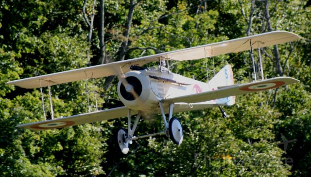 — — - A pretty day at Old Rhinebeck. A SPAD VII makes a low pass.