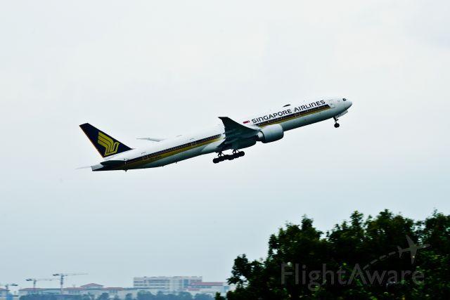 BOEING 777-300ER (9V-SWU) - 777-300ER rocketing out of Singapore Changi