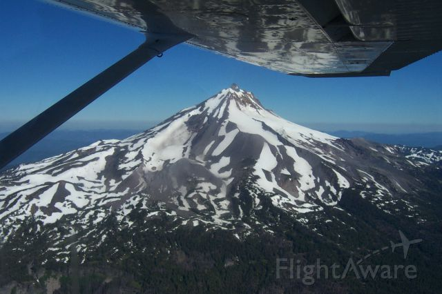 Cessna Skyhawk — - Flying close to Mt. Jefferson in the Cascade Mountain Range in Oregon (note the distorted reflection of the mountain on the wing)