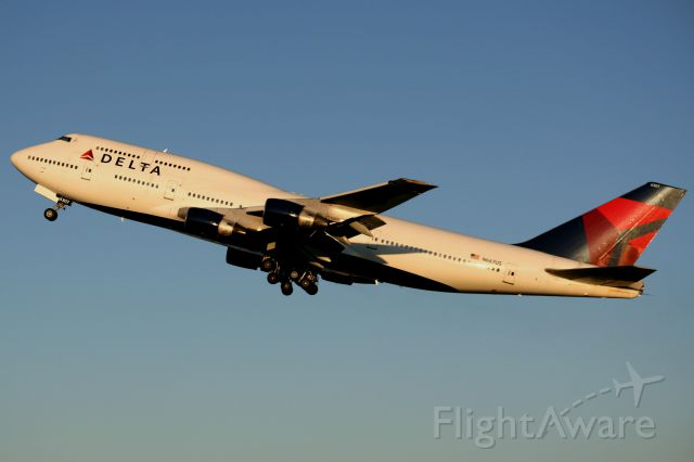 Boeing 747-400 (N667US) - Deltas Ship # 6307 departs ANC in the last light of the day, bound for Narita