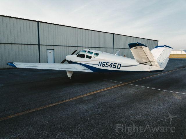 Beechcraft 35 Bonanza (N5545D) - Pushing the plane back in the hangar after a great evening trip.
