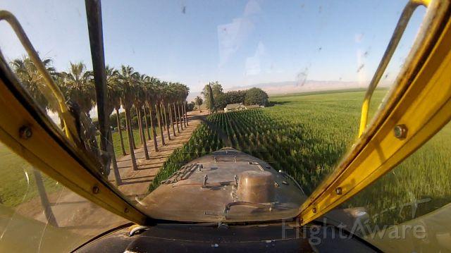 — — - AT 502 Spraying corn near Bakersfield CA.