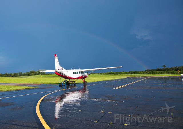 Cessna Caravan (N694DA) - Passing shower.