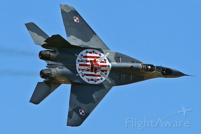 — — - Specially-painted MiG-29, Polish Air Force, banking hard right during it