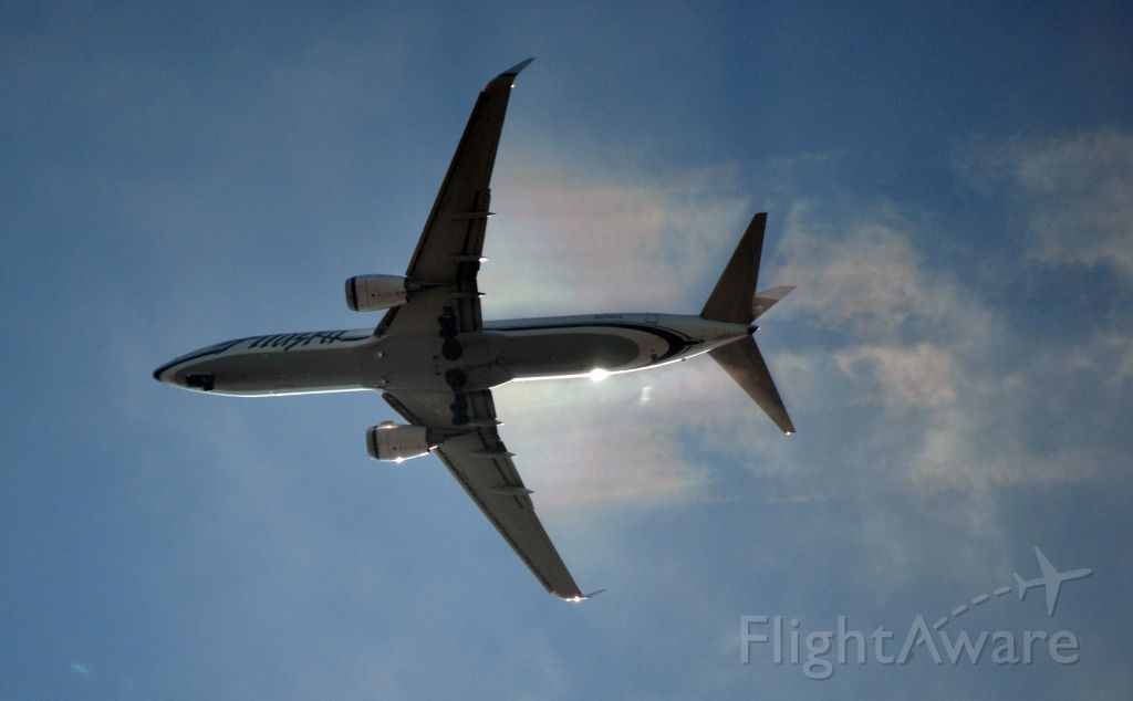 Boeing 737-700 (N570AS) - Making rainbows in the cool Seattle afternoon.
