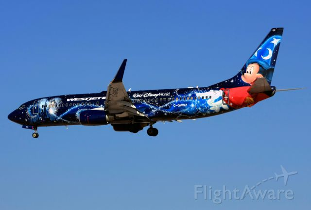Boeing 737-800 (C-GWSZ) - WestJets Disney plane About to land on RWY25L at Las Vegas on a sunny winter morning.