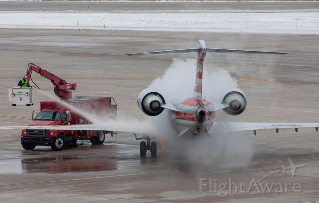 Canadair Regional Jet CRJ-900 (N589NN) - One cold afternoon in December this beauty pulled right out in front of us and made for perfect de-icing pictures! This shot was taken on a Canon EOS 50D at 180mm.